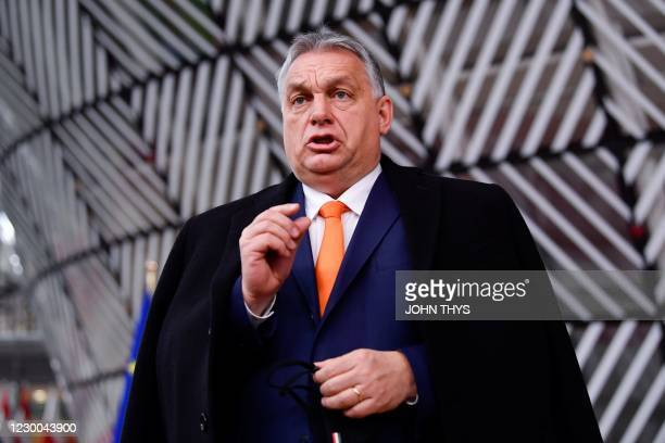 Hungary's Prime Minister Viktor Orban speaks to the press as he arrives at the EU headquarters' Europa building in Brussels on December 10 prior to a...