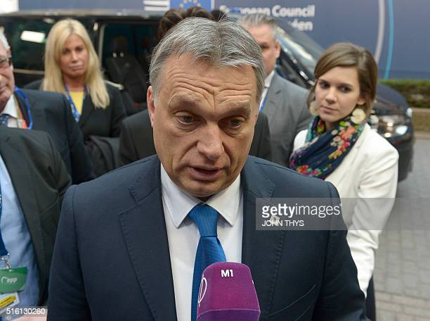 Hungary's Prime minister Viktor Orban speaks to the press as he arrives for the European Union summit in Brussels on March 17 where 28 EU leaders...