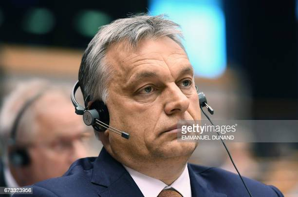 Hungary's Prime Minister Viktor Orban takes part in a planery session at the European Parliament on the situation in Hungary in Brussels on Avril 26...