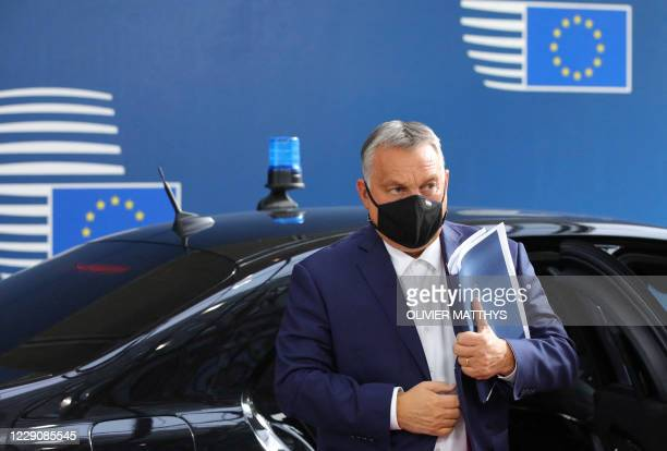 Hungary's Prime Minister Viktor Orban wearing face mask arrives ahead of a two days European Union summit at the European Council Building in...