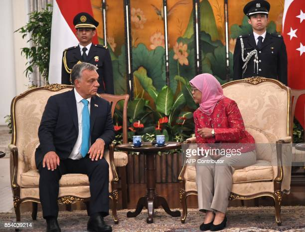 Hungary's Prime Minister Viktor Orbán chats with Singapore President Halimah Yacob during a meeting at Istana presidential palace in Singapore on...