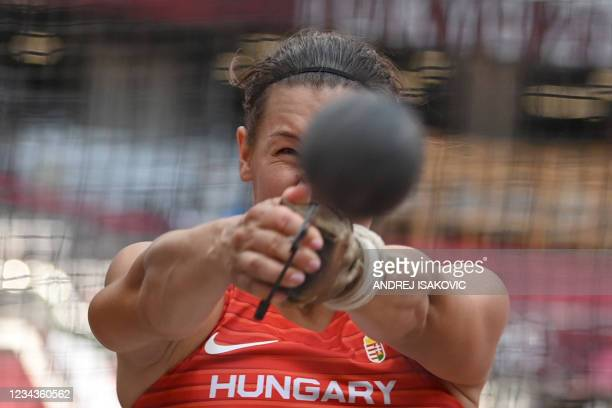 Hungary's Reka Gyuratz competes in the women's hammer throw qualification during the Tokyo 2020 Olympic Games at the Olympic Stadium in Tokyo on...