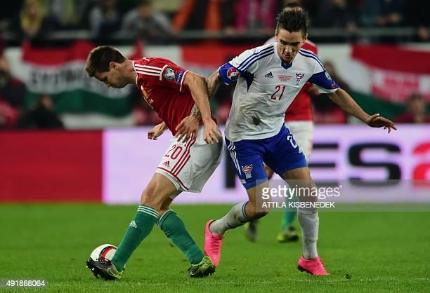 Hungary's Richard Guzmics vies with Faroe Island's Rene Joensen during the Euro 2016 Group F qualifying football match between Hungary and Faroe...