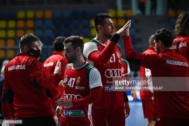Hungary's right winger Peter Hornyak , Hungary's pivot Bence Banhidi and teammates celebrate their victory at the end of the 2021 World Men's...