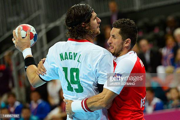 Hungary's rightback Laszlo Zoltan Nagy vies with Iceland's rightwing Alexander Petersson during the men's quarterfinal handball match Iceland vs...