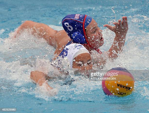 Hungary's Rita Keszthelyi fights for the ball with Russia's Maria Borisova during the women's Water Polo European Championships match Hungary vs...