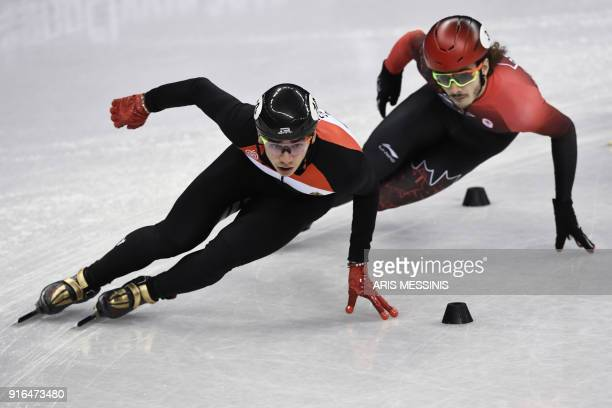 Hungary's Sandor Liu Shaolin and Canada's Samuel Girard take part in the men's 1,500m short track speed skating heat event during the Pyeongchang...