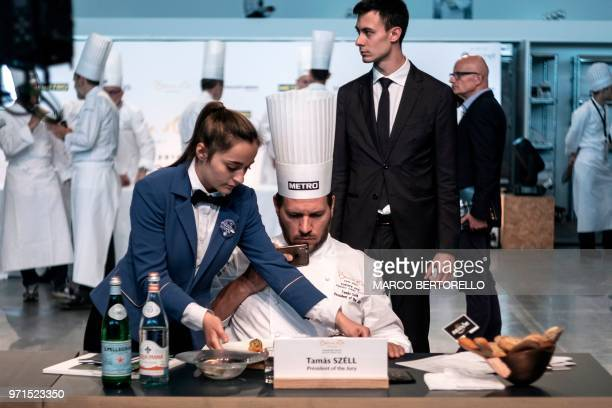 TOPSHOT Hungary's Tamas Szell president of the jury takes a picture during the Europe 2018 Bocuse d'Or International culinary competition on June 11...