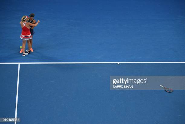 TOPSHOT Hungary's Timea Babos and France's Kristina Mladenovic celebrate beating Russia's Ekaterina Makarova and Elena Vesnina in their women's...