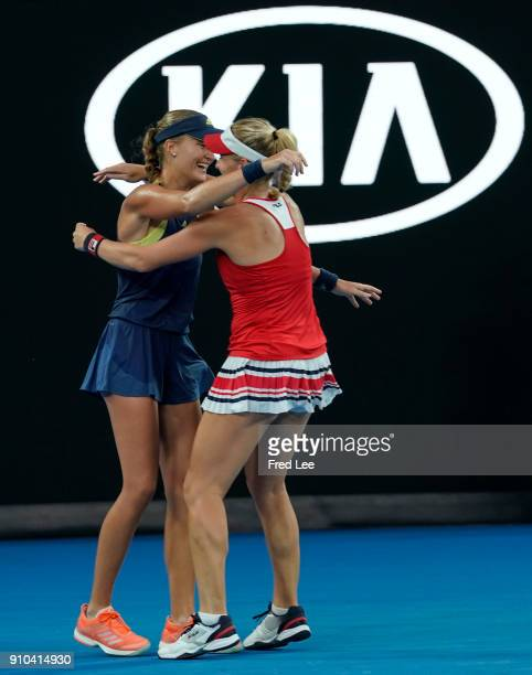Hungary's Timea Babos and France's Kristina Mladenovic celebrate beating Russia's Ekaterina Makarova and Elena Vesnina in their women's doubles final...