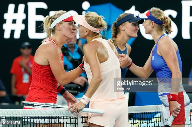Hungary's Timea Babos and France's Kristina Mladenovic embrace as they celebrate after victory over Russia's Ekaterina Makarova and Elena Vesnina in...