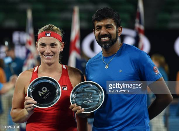 Hungary's Timea Babos and India's Rohan Bopanna pose with their runnerup plates after losing to Croatia's Mate Pavic and Canada's Gabriela Dabrowski...