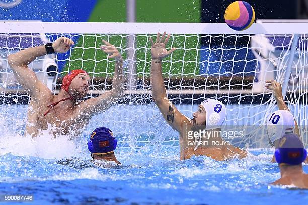 Hungary's Viktor Nagy saves a goal during the Rio 2016 Olympic Games waterpolo quaterfinal match against Montenegro at the Olympic Aquatics Stadium...