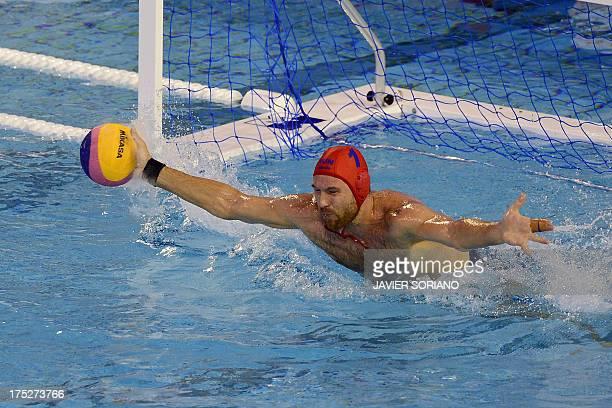 Hungary's Viktor Nagy stops a shot during the men's water polo semifinal match Hungary vs Croatia at the FINA World Championships at the Bernat...