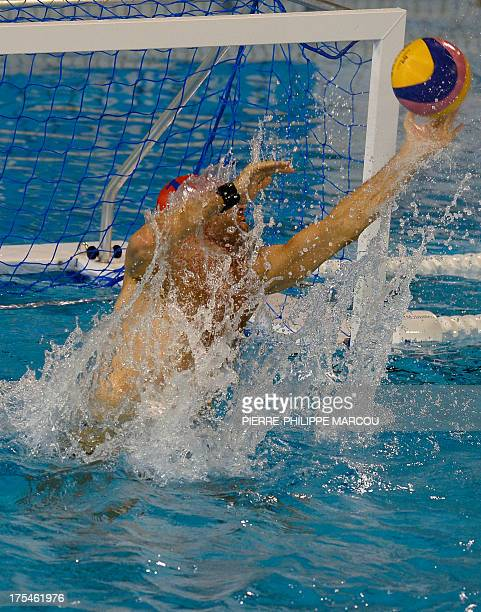 Hungary's Viktor Nagy stops the ball during the men's water polo final match Montenegro vs Hungary at the FINA World Championships on August 3 2013...