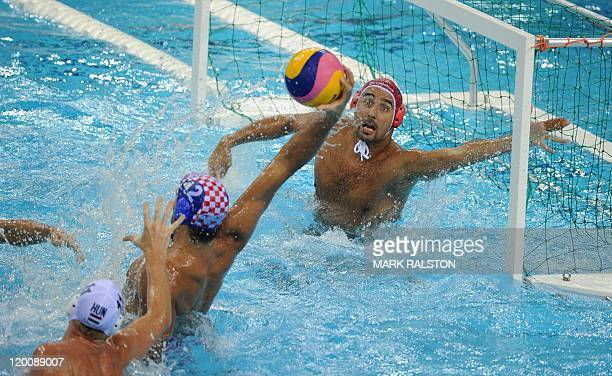 Hungary's Viktor Nagy tries to stop a ball next to teammate Adam Steinmetz and Croatia's Damir Buric as they compete in the men's water polo bronze...
