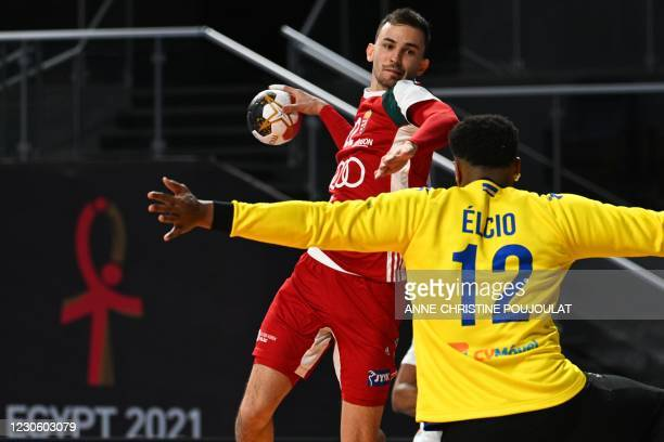 Hungary's wing Stefan Sunajko shoots at Cape Verde's goalkeeper Elcio Fernandes during the 2021 World Men's Handball Championship between Group A...