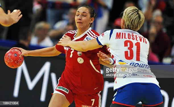 Hungary's Zita Szucsanszki vies for the ball with Serbia's Ivana Milosevic during the women's EHF Euro 2012 Handball Championship small final match...