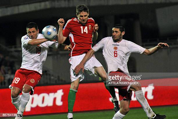 Hungary's Zoltan Gera scores a goal between Maltese defender Shaun Bajada and Jonathan Carvana during their World Cup 2010 qualification match at...