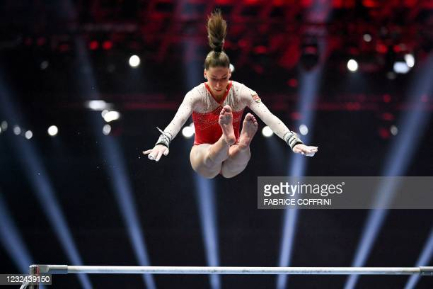 Hungary's Zsofia Szekely competes in the Women's uneven bars qualifications during European Artistic Gymnastics Championships at the St Jakobshalle,...