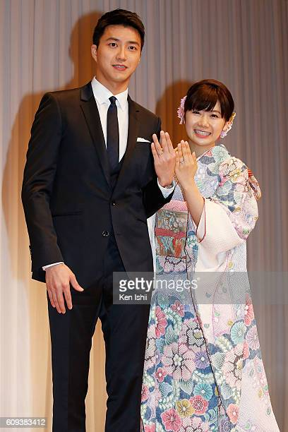 HungChieh Chiang of Chinese Taipei and Ai Fukuhara of Japan pose for photographs during press conference on September 21 2016 in Tokyo Japan Japanese...