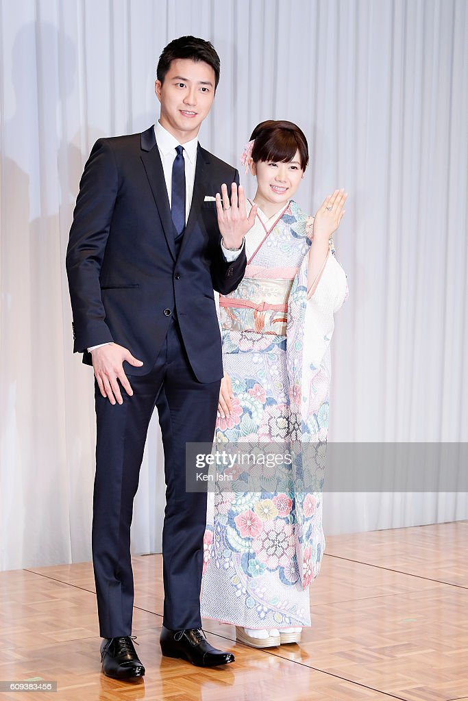 Hung-Chieh Chiang of Chinese Taipei and Ai Fukuhara of Japan pose for photographs during press conference on September 21, 2016 in Tokyo, Japan. Japanese table tennis player Ai Fukuhara recently married Taiwanese table tennis player Hung-Chieh Chiang.