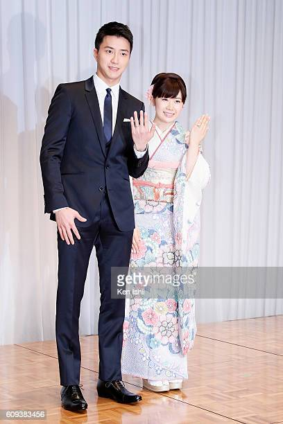 Hung-Chieh Chiang of Chinese Taipei and Ai Fukuhara of Japan pose for photographs during press conference on September 21, 2016 in Tokyo, Japan....