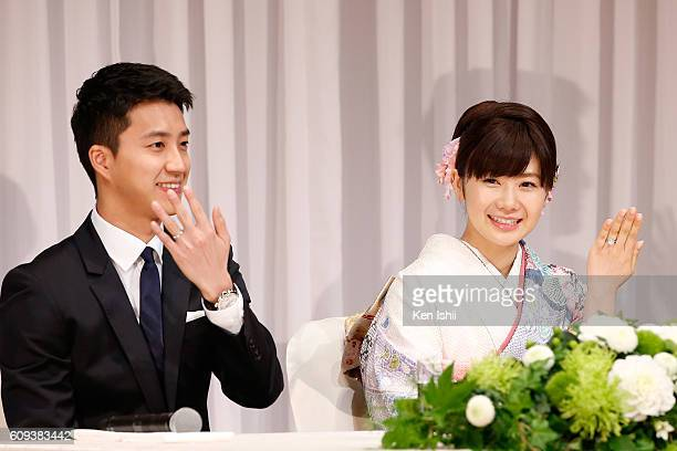 HungChieh Chiang of Chinese Taipei and Ai Fukuhara of Japan show their engagement ring during press conference on September 21 2016 in Tokyo Japan...