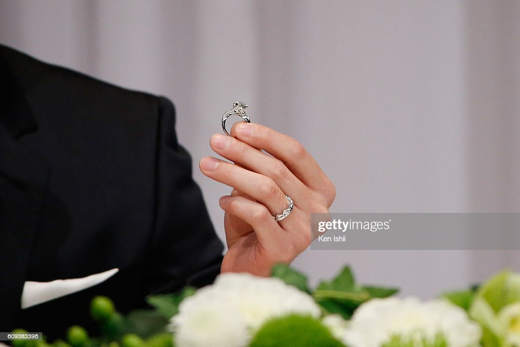 Hung-Chieh Chiang of Chinese Taipei shows their engagement ring during press conference on September 21, 2016 in Tokyo, Japan. Japanese table tennis player Ai Fukuhara recently married Taiwanese table tennis player Hung-Chieh Chiang.