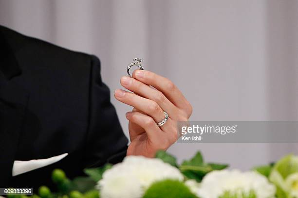 Hung-Chieh Chiang of Chinese Taipei shows their engagement ring during press conference on September 21, 2016 in Tokyo, Japan. Japanese table tennis...