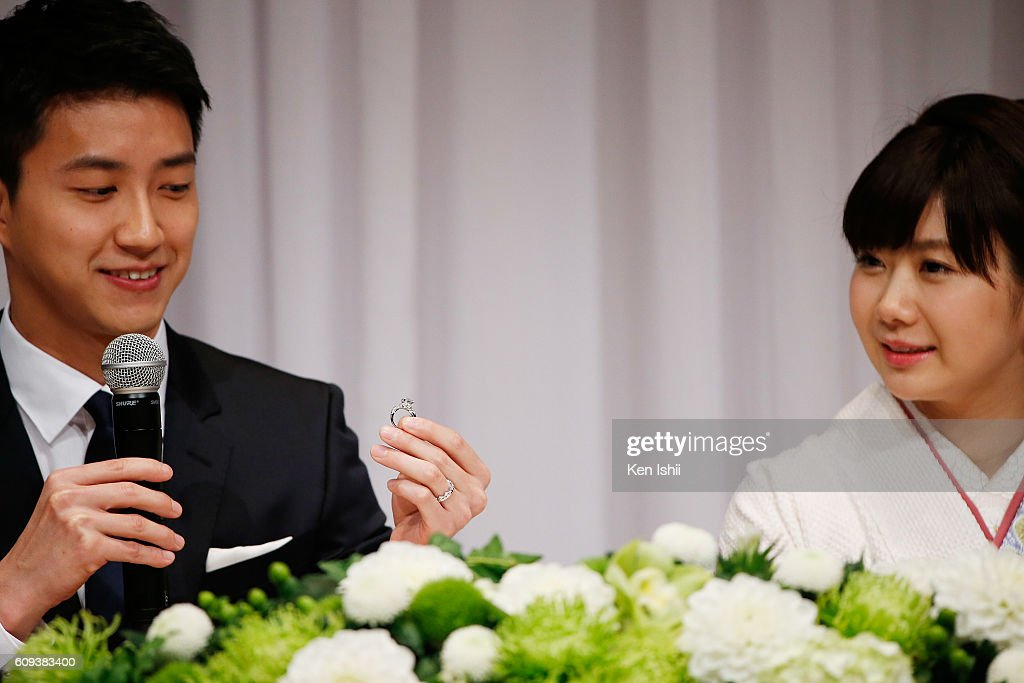 Hung-Chieh Chiang (L) of Chinese Taipei shows their engagement ring during press conference on September 21, 2016 in Tokyo, Japan. Japanese table tennis player Ai Fukuhara recently married Taiwanese table tennis player Hung-Chieh Chiang.