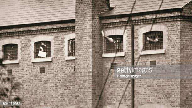 Hunger strikers waving to Christabel Pankhurst from their cells in Holloway Prison London 1909 The fourteen suffragettes went on hunger in protest at...