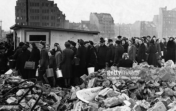 Hungry crowd of people in the city of Hamburg Germany March 26 1946 during the aftermath of World war Two