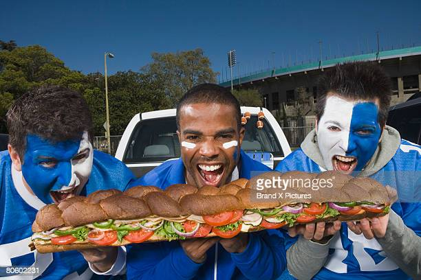hungry fans with sandwich - grinder sandwich stock pictures, royalty-free photos & images