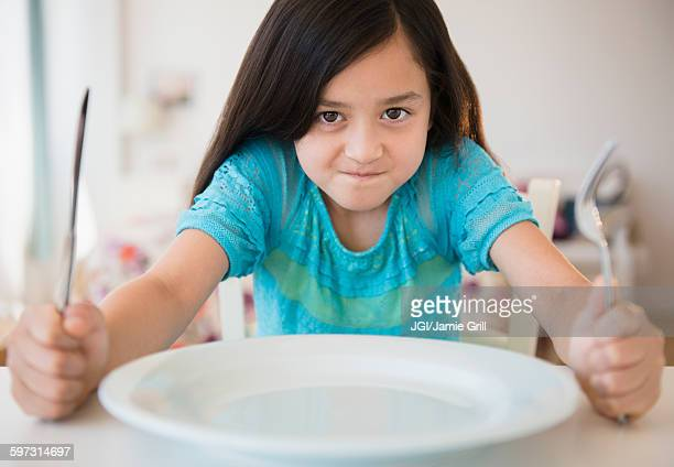 hungry girl impatient for food - hongerig stockfoto's en -beelden
