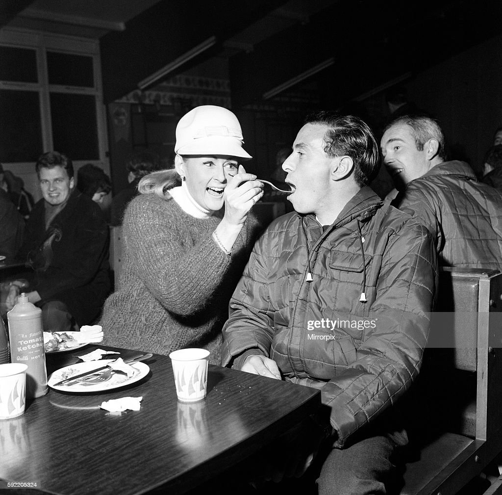 A Hungry Jim Clark Racing Driver Competing In The 1966 RAC Rally Around Britain Is Fed Couple Of Chips By Fellow Rosemary Smith As He Waits For His