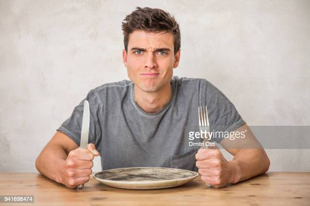 Hungry man waiting for food