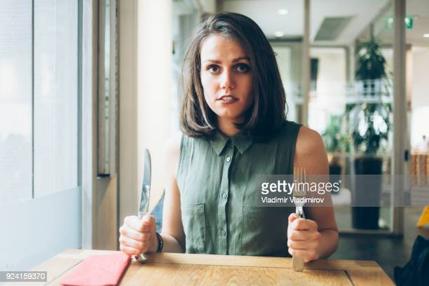 hungry young woman waiting for her lunch - hungry stock pictures, royalty-free photos & images