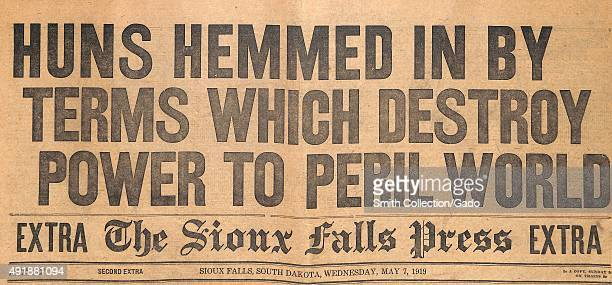 Huns Hemmed in By Terms Which Destroy Power to Peril World newspaper front page headline for the Sioux Falls Press announcing the surrender of...