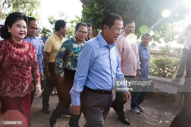HunSenCambodia'sprimeministerandpresidentoftheCambodianPeople'sParty center arrives at a polling station to cast his ballot for the...