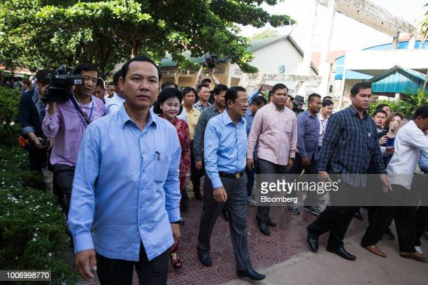 HunSenCambodia'sprimeministerandpresidentoftheCambodianPeople'sParty center leaves a polling station after casting his ballot for the...