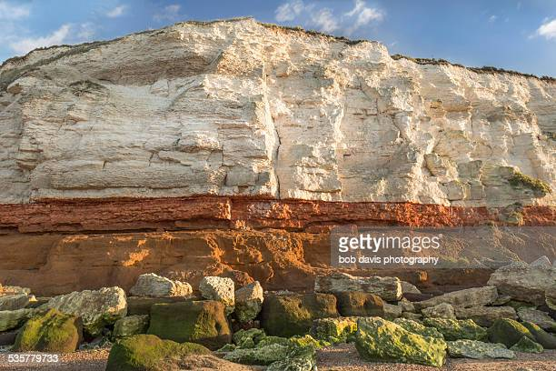 hunstanton cliffs - rock strata stock pictures, royalty-free photos & images