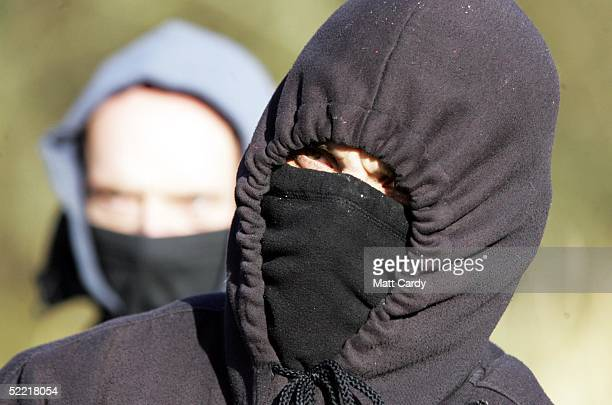 A hunt sabatuer watches the Avon Vale Hunt at Monk's Park on February 19 2005 near Corsham Wiltshire England Some hunts are abiding to the new...