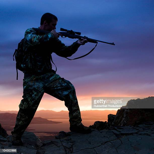 hunter against a sunset - pic hunter stock pictures, royalty-free photos & images