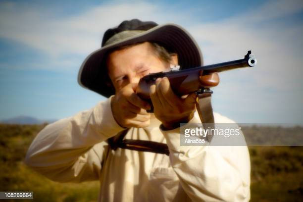 hunter aiming a rifle - gun barrel stock pictures, royalty-free photos & images