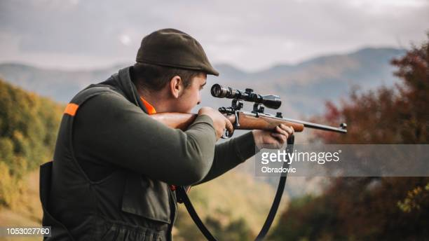 hunter aiming wild boar - portrait - rifle stock pictures, royalty-free photos & images