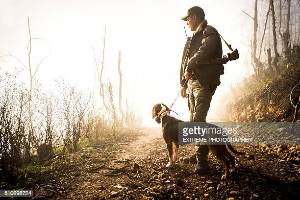 hunter and his dog in the forest - hunting sport stock pictures, royalty-free photos & images