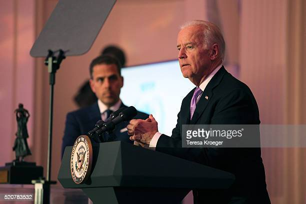 Hunter Biden and US Vice President Joe Biden speak on stage at the World Food Program USA's Annual McGovernDole Leadership Award Ceremony at...