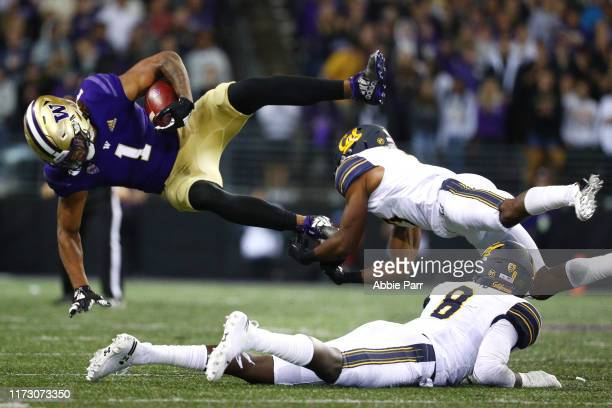 Hunter Bryant of the Washington Huskies is tackled by Elijah Hicks of the California Golden Bears in the second quarter during their game at Husky...