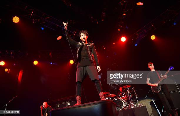 Hunter Burgan Davey Havok Adam Carson and Jade Puget of the band AFI perform onstage at 1067 KROQ Almost Acoustic Christmas 2016 Night 1 at The Forum...